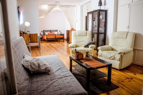 Zona de estar de Apartamentos Teatro Romano