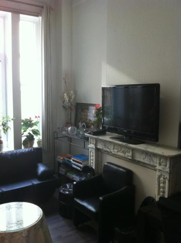 A television and/or entertainment center at Résidence18