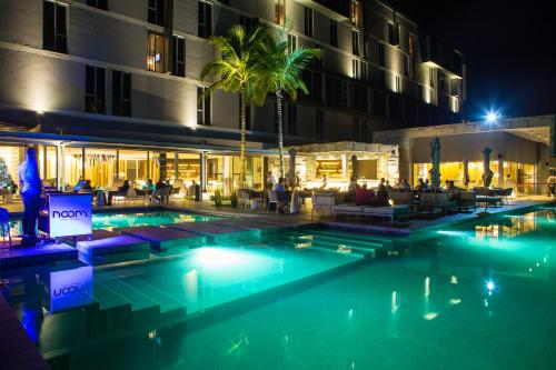 The swimming pool at or near Noom Hotel Conakry