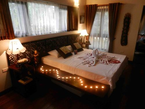 A bed or beds in a room at Moon Garden Homestay