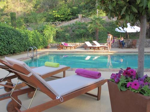 The swimming pool at or near Masia Sagués