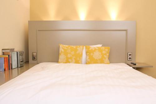 Ein Bett oder Betten in einem Zimmer der Unterkunft Romantik Hotel Friedrich von Schiller