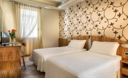 Letto o letti in una camera di ACasaMia WelcHome Hotel