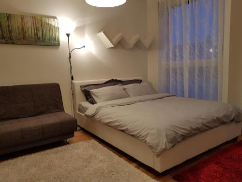 A bed or beds in a room at Rotermanni Guest Apartments