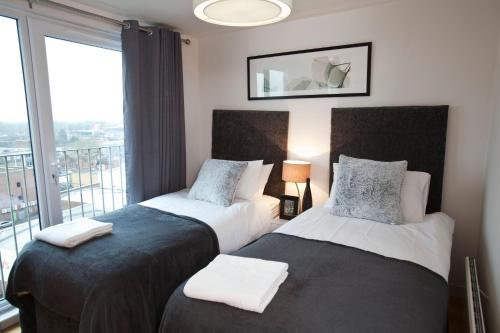A bed or beds in a room at Watford Centre - Luxury Penthouse