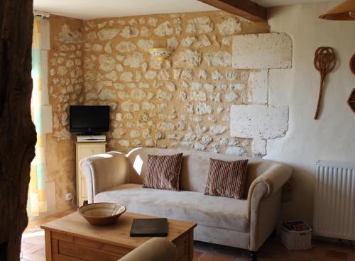A seating area at Les Jolies Arches, Manoir de Longeveau