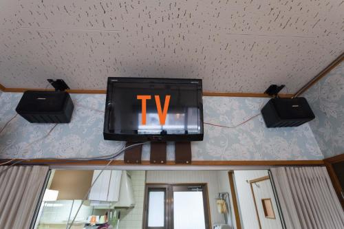 A television and/or entertainment center at ML International Hostel