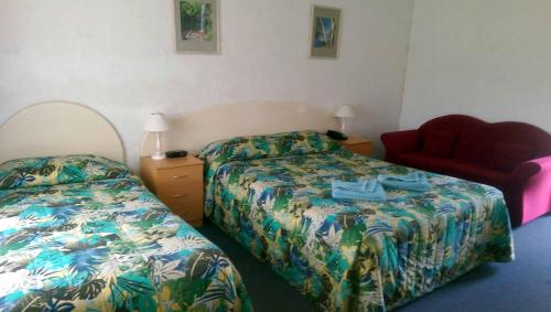 A bed or beds in a room at The Nambucca Motel