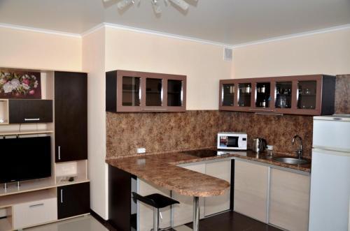 A kitchen or kitchenette at Apartments RING Zheleznovodsk