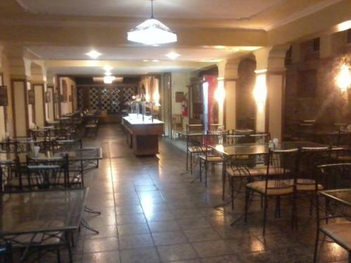 A restaurant or other place to eat at Hotel Castel