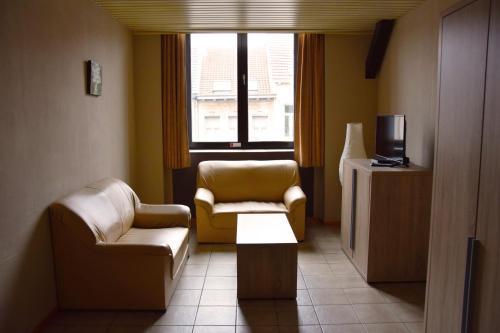 Ein Sitzbereich in der Unterkunft Condo Gardens Antwerp