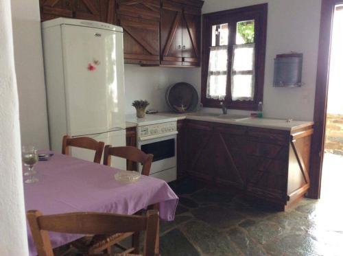 Η κουζίνα ή μικρή κουζίνα στο Village Bay Studios