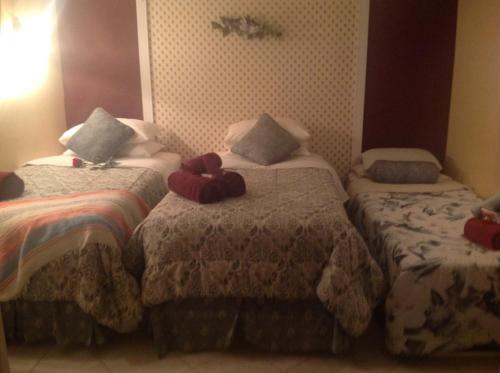 Un ou plusieurs lits dans un hébergement de l'établissement Gite La Jeanne-Claire Couette & CAfé