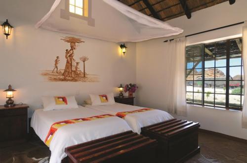 Letto o letti in una camera di Gondwana Canyon Village