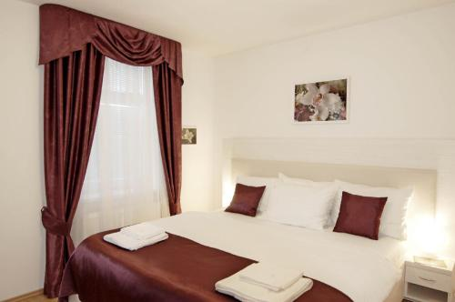 A bed or beds in a room at Residence Hermanova