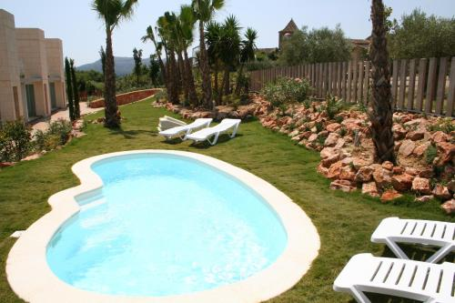 Vista de la piscina de L' Escala Resort o alrededores