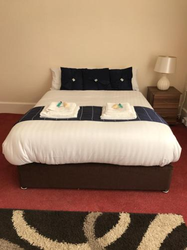 A bed or beds in a room at Assheton Arms Hotel
