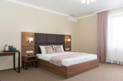 A bed or beds in a room at Hotel Chaika