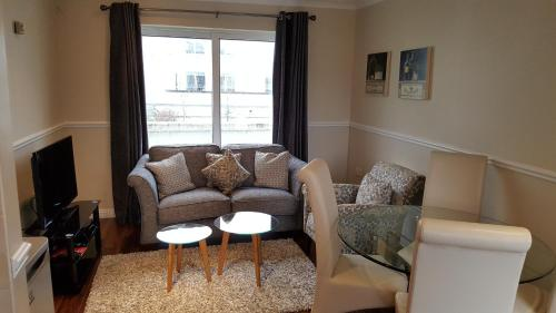 A seating area at St Bridget's Serviced Apartments
