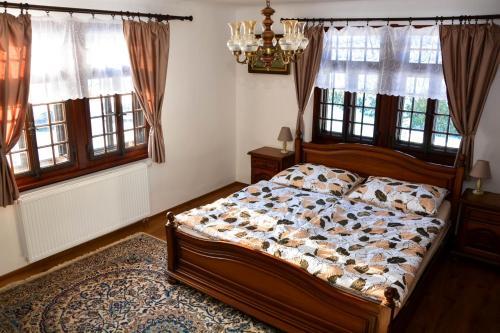 Postel nebo postele na pokoji v ubytování Apartman Forstamt Glatzen Kladska