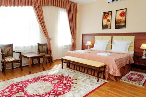 A bed or beds in a room at Spa Hotel Slavyanovsky Istok
