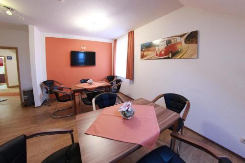 Ein Restaurant oder anderes Speiselokal in der Unterkunft Pension Am Ostbahnhof