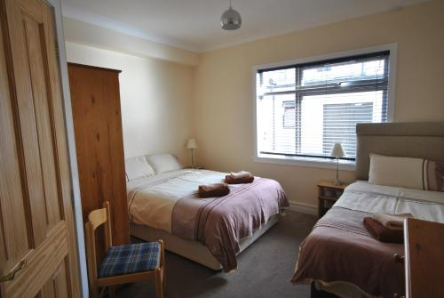 A bed or beds in a room at Glenarroch