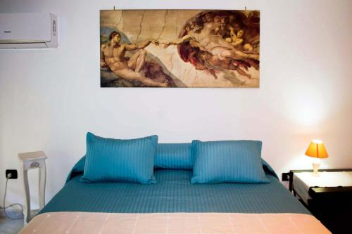 A bed or beds in a room at B&B Antica Napoli