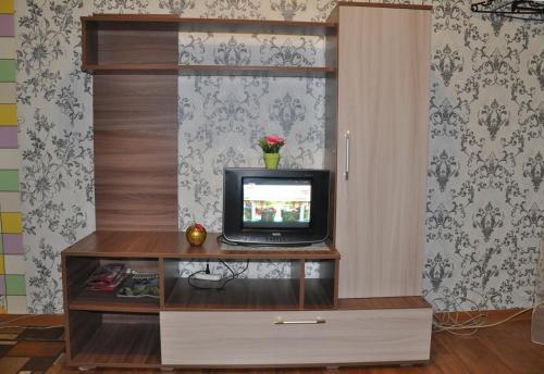 A television and/or entertainment center at Apartments at Serafimovicha 30