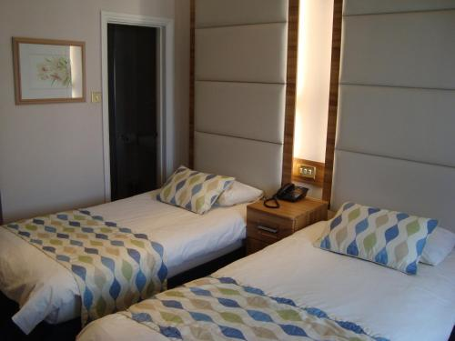 A bed or beds in a room at Royal Eagle Hotel