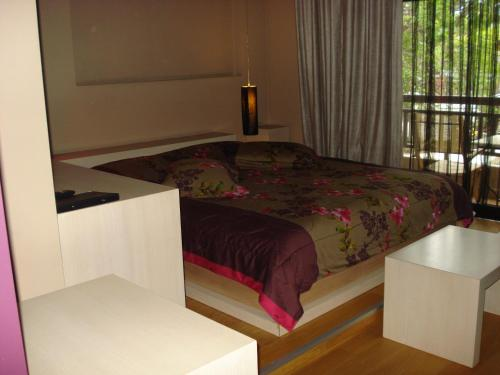 A bed or beds in a room at Hotel Koziakas