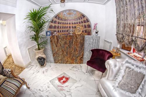 Letto o letti in una camera di B&B Palazzo del Teatro