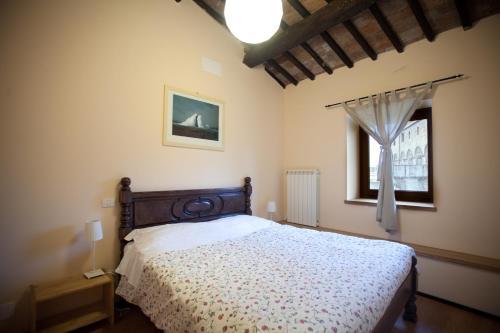 Letto o letti in una camera di La Soffitta e La Torre