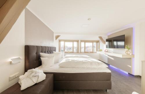 Ein Bett oder Betten in einem Zimmer der Unterkunft Rabe Mühlhausen