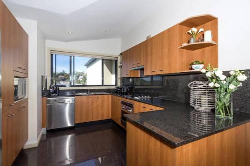 A kitchen or kitchenette at Bondi Beach Lamrock Avenue