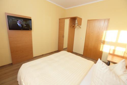 Ein Bett oder Betten in einem Zimmer der Unterkunft Appartementhotel in Stade