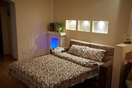 A bed or beds in a room at Babylon Apartments on Petliury Street