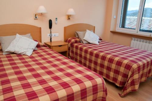 A bed or beds in a room at Hotel Villa de Ayerbe