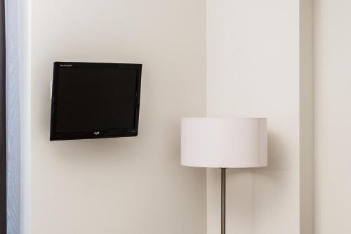 A television and/or entertainment centre at Tag Hotel