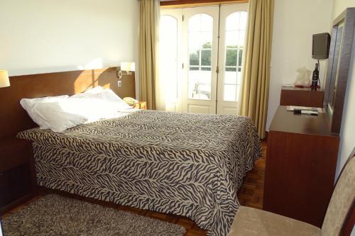 Cama o camas de una habitación en Hotel Mira Rio
