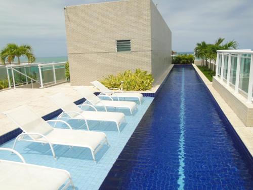 The swimming pool at or close to Gray Home Maceio - Condominio JTR