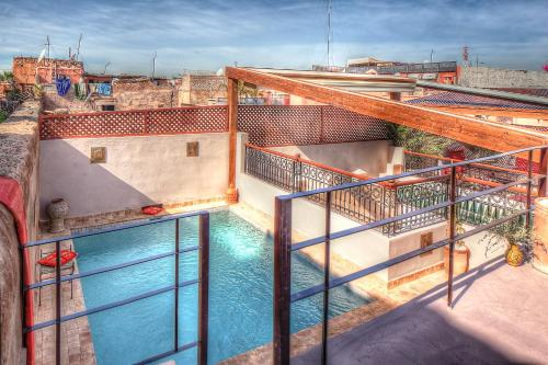 A view of the pool at Riad Carina or nearby