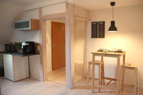 Küche/Küchenzeile in der Unterkunft Ferienwohnung Kirchturmblick Euren