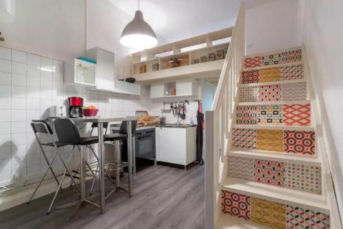 A kitchen or kitchenette at Apartment Pierre Scize Sur La Saône