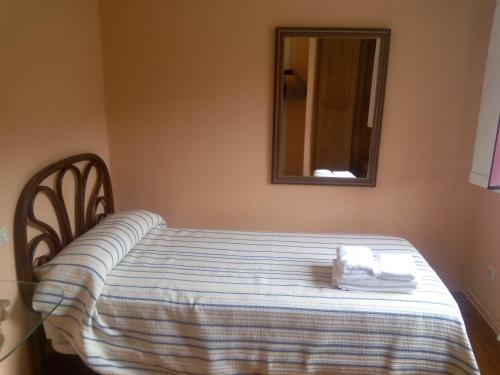 A bed or beds in a room at Hotel Las Grandas