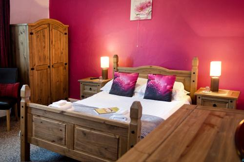 A bed or beds in a room at The Boars Head