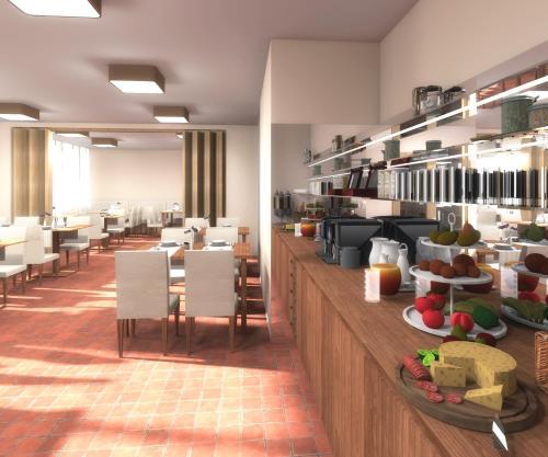 Ein Restaurant oder anderes Speiselokal in der Unterkunft Baum´s Rheinhotel