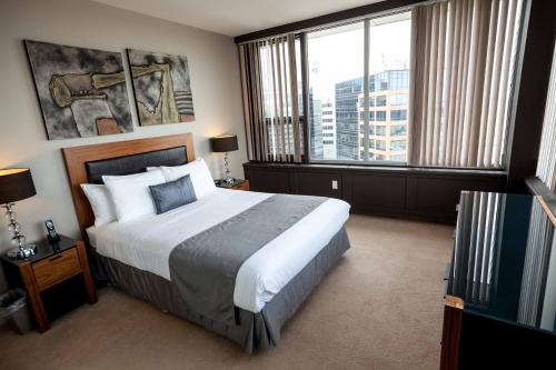 A bed or beds in a room at The Hamilton by OBASA Six Three Suites