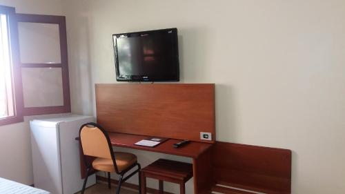 A television and/or entertainment center at Angatu Hotel