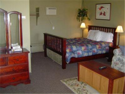 A bed or beds in a room at Carravalla Inn